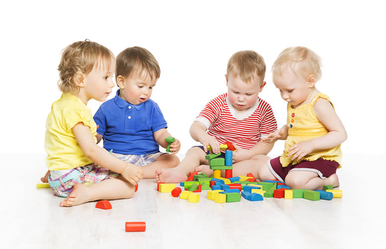 children at a local daycare playing with toys