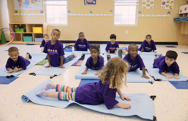 young preschool girl doing yoga
