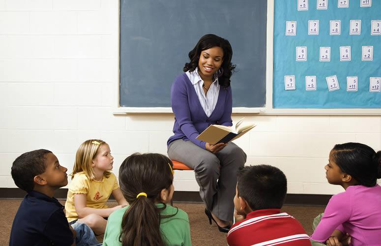 Preschool Teacher Reading A Book