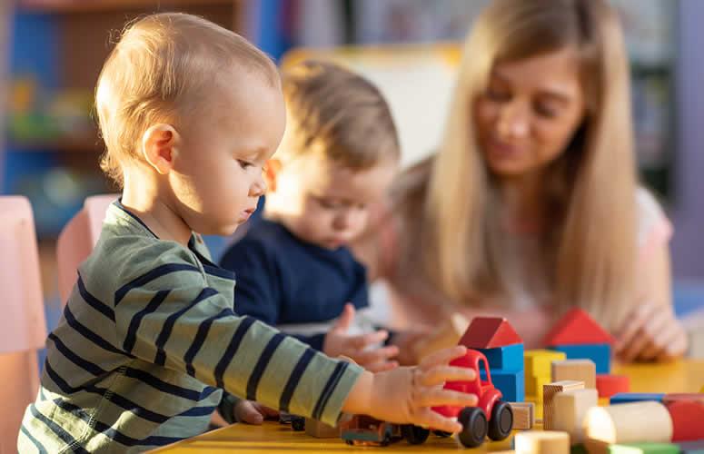 preschool teacher with boys